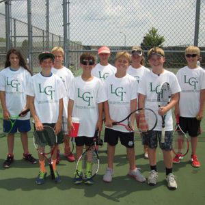 Young tennis players pose with LGT shirts.