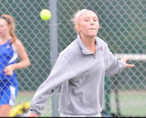 Badger High School girls tennis player Claudia Huerth hits a backhand slice.