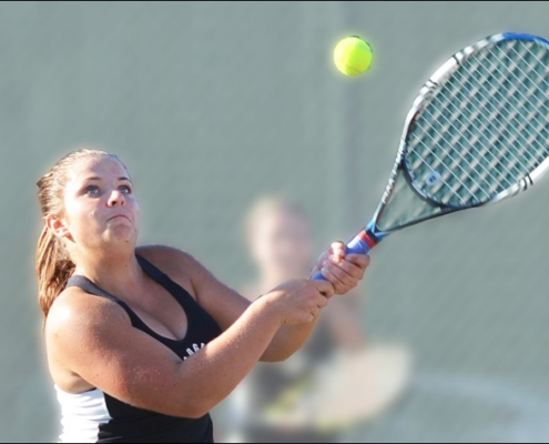 Badger High School tennis player Joanne Walczynski hits a backhand.