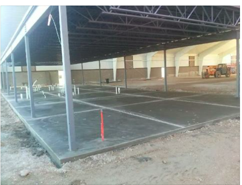 Cement is poured for LGT offices, locker rooms, and reception area.